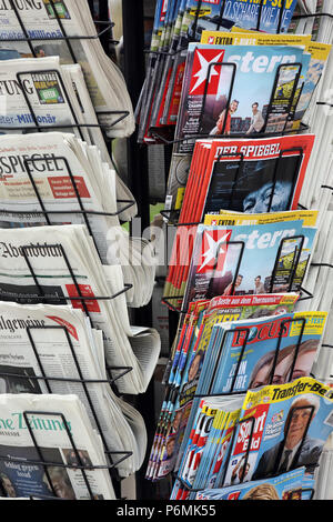 Warnemuende, daily newspapers and magazines in a newspaper stand - Stock Photo