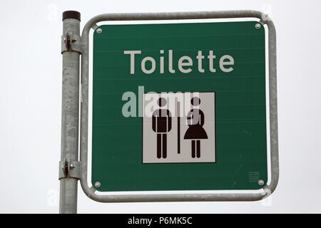 Warnemuende, sign, public toilet - Stock Photo