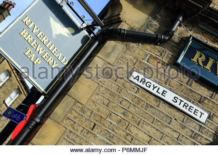 Riverhead Brewery Tap pub sign in the Yorkshire Town of Marsden, Summer July 2018 - Stock Photo