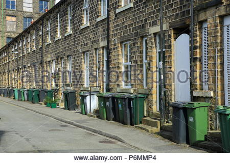 A row of traditional Yorkshire terraced houses in the Yorkshire Town of Marsden, Summer July 2018 - Stock Photo