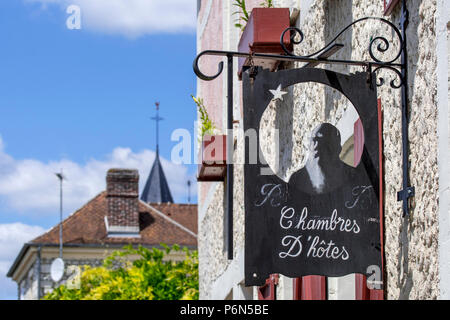 Sign showing silhouette of Impressionist painter Claude Monet at Le Coin des Artistes, chambre d'hôtes at Giverny, Eure department, Normandy, France - Stock Photo