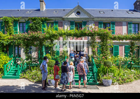 Tourists visiting the garden and house in summer of Impressionist painter Claude Monet in Giverny, Eure, Normandy, France - Stock Photo