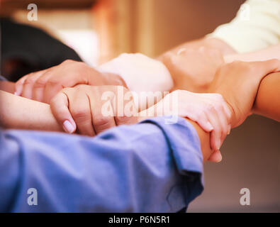 Business people joining stacking hands in a meeting at mobile office. Team work, Unity, Harmony, Cooperation, collaboration concept. - Stock Photo