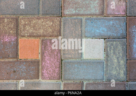 Pavement tile painted with colorful chalks. Children drawing on street. Bright multicolored background - Stock Photo