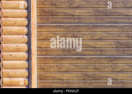 Close-up detail of wall covered with wooden siding. Part of automatic garage door . Car storage building facade part - Stock Photo