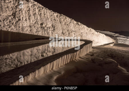 Nightscape shot of Natural travertine pools and terraces in Pamukkale. Cotton castle in southwestern Turkey, - Stock Photo