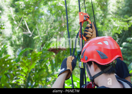 Work safe background concept.Soft focus close up young man Asian use safety harness with equipment for job at heigh critical hazard area industrial .F - Stock Photo