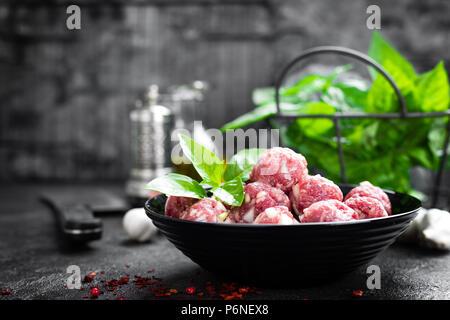 Beef meatballs. Cooking raw beef meatballs - Stock Photo