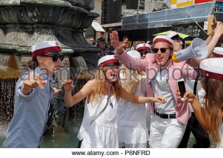 Danish students celebrate their high school graduation with the traditional dance round and plunge into the Stork Fountain on Stroeget in Copenhagen. - Stock Photo