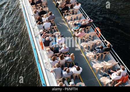 Berlin, Germany - june 2018: Group of tourists / people on tourist sightseeing boat from above in Berlin, Germany - Stock Photo