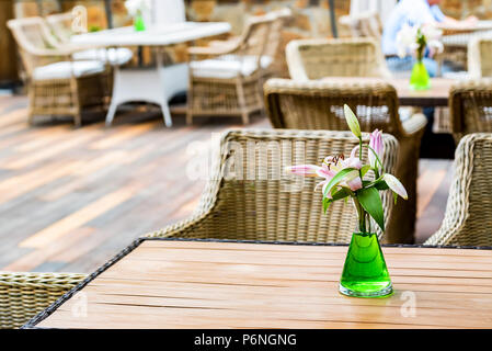 Outdoor restaurant interior with wicker chairs - Stock Photo