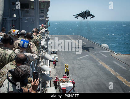 180622-N-AH771-0158 ARABIAN GULF (June 22, 2018) U.S. Army Gen. Joseph Votel, commander of U.S. Central Command, and other distinguished visitors view a flight demonstration while touring the Wasp-class amphibious assault ship USS Iwo Jima (LHD 7). Iwo Jima, homeported in Mayport, Fla., is on deployment to the U.S. 5th Fleet area of operations in support of maritime security operations to reassure allies and partners, and preserve the freedom of navigation and the free flow of commerce in the region. (U.S. Navy photo by Mass Communication Specialist 3rd Class Daniel C. Coxwest/Released) - Stock Photo