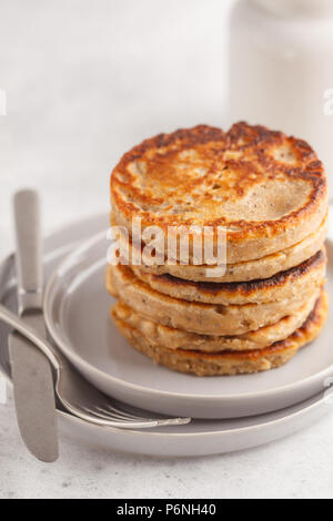 Vegan pancakes with chia seeds on a white plate, white background. Healthy vegan food concept. - Stock Photo
