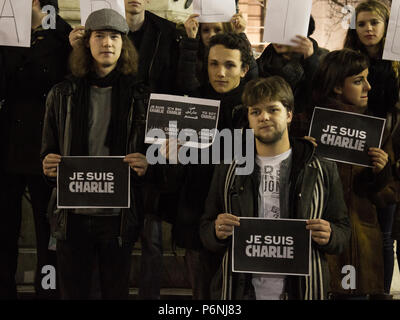 BELGRADE, SERBIA - JANUARY 10, 2015: Young people holding 'Je suis Charlie' signs during a demonstration to commemorate the 7th of January attacks aga - Stock Photo