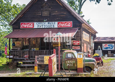 Crazy Mule Antiques, located in a 1909 Lula, Georgia general store building in the foothills of the Blue Ridge Mountains. (USA) - Stock Photo