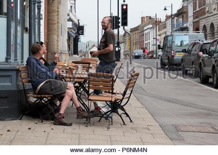 Group of men drinking outside a High Street pub, Bridport, Dorset, England, UK - Stock Photo