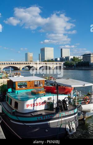 Boats on the Seine with a pont de Bercy, Paris, IDF, France - Stock Photo