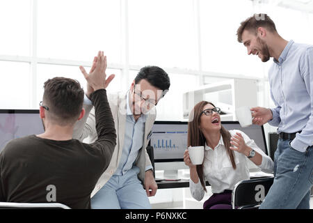 business colleagues giving each other a high five - Stock Photo
