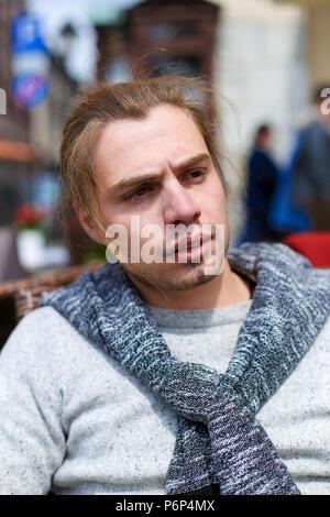 Portrait of handsome caucasian man wearing grey sweater. - Stock Photo