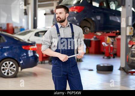 Bearded Mechanic Working in Car Service - Stock Photo