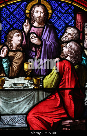 Basel Cathedral Minster. Stained glass window.  The Last Supper is the final meal that Jesus shared with his Apostles.  Switzerland. - Stock Photo