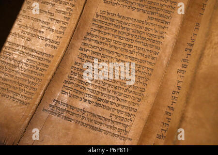 Jewish Museum of Switzerland. Basel.  Old Torah scroll with Hebrew writing (1720). Close-up. - Stock Photo