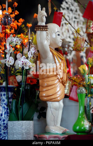 Chua Tu An Buddhist temple.  Infant Buddha statue.  Saint-Pierre en Faucigny. France. - Stock Photo