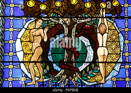 Notre Dame de Clermont cathedral, Clermont-Ferrand, France. Stained glass. Genesis. Adam & Eve in paradise.