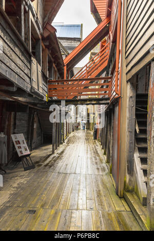 Old Hanseatic buildings of Bryggen in Bergen, Norway, inner view of a narrow lane with gallery - Stock Photo