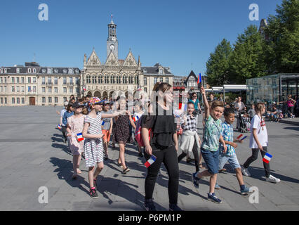 School teacher and pupils stundents marching on Victory In Europe VE day 8th May 2018 in Place de l'Hotel de Ville St Quentin, Aisne, France. - Stock Photo