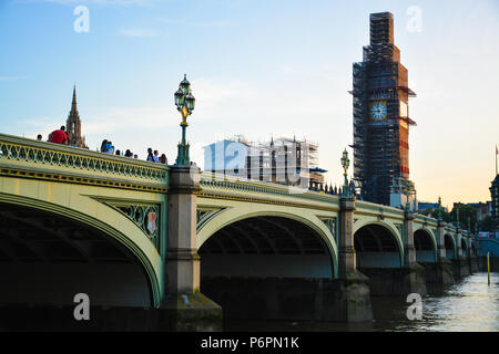 Westminster bridge over the Thames river and the Clock tower (Big Ben) under construction. - Stock Photo