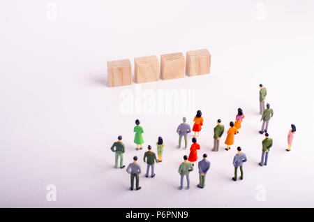 People are looking at a standing four wooden cube with letters on a white background. Place for letters on the squares. template for a four-letter wor - Stock Photo