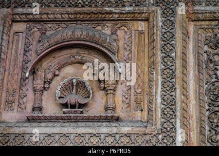 Detail of an exhibit of a gateway to a haveli or mansion typical of Rajasthan with a chipmunk at corner, National Crafts Museum, New Delhi, India - Stock Photo