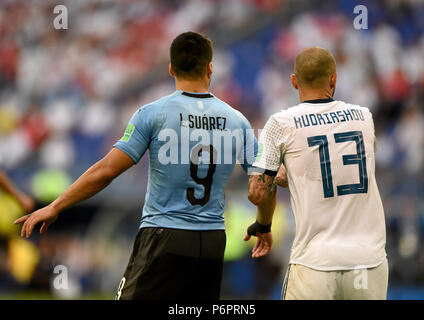 Samara, Russia - June 25, 2018. Russian defender Fedor Kudryashov and Uruguayan striker Luis Suarez during FIFA World Cup 2018 match Uruguay vs Russia - Stock Photo