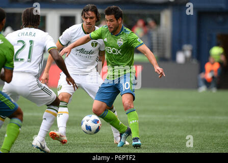 Seattle, Washington, USA. 30th June, 2018. DIEGO CHARA (21) defends against the Sounders midfielder NICO LODEIRO (10) as the Portland Timbers play the Seattle Sounders in a Western Conference match at Century Link Field in Seattle, WA. Credit: Jeff Halstead/ZUMA Wire/Alamy Live News - Stock Photo