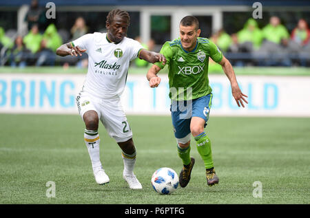 Seattle, Washington, USA. 30th June, 2018. The Sounders VICTOR RODRIGUEZ (8) and the Timbers DIEGO CHARA (21) battle for the ball as the Portland Timbers play the Seattle Sounders in a Western Conference match at Century Link Field in Seattle, WA. Credit: Jeff Halstead/ZUMA Wire/Alamy Live News - Stock Photo