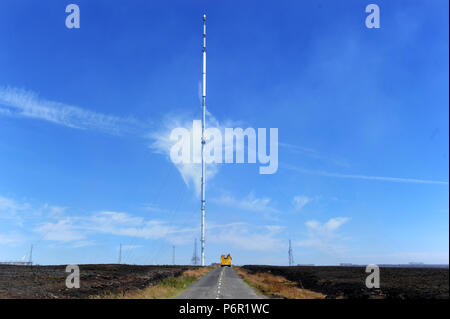 Bolton, UK. 2nd July 2018. More than 100 firefighters from Lancashire and other forces continue to tackle a huge moorland fire on Winter Hill near Boltonn, Lancashire. The blaze was started deliberately and has been raging for five days covering an area of seven square kilometres. Winter Hill television transmitter mast. Picture by Paul Heyes, Monday July 02, 2018. Credit: Paul Heyes/Alamy Live News - Stock Photo