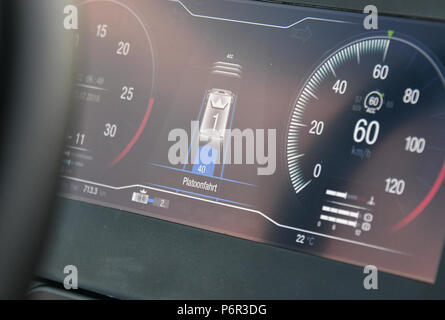 02 July 2018, Germany, Selchow: A truck's dashboard indicating 'platoon driving mode' during a demonstration of platooning in autonomous driving in the unused south strip of Schoenefeld Airport. Platooning is convoy driving with very small distances between trucks through the aid of a technological driving system. DB Schenker, MAN Truck & Bus and the Fresenius University of Applied Sciences are for the first time testing truck platooning under actual driving conditions. In this test trucks are connected through a technological driver assistance and control system, as well as an electronic pivo - Stock Photo