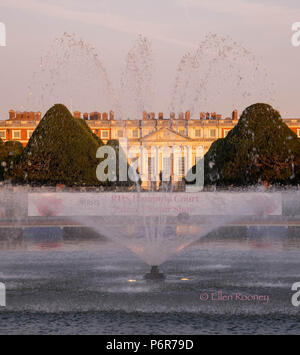 A fountain in front of Hampton Court Palace on opening day of the Hampton Court Palace Flower Show - Stock Photo
