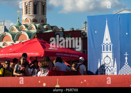 FIFA World Cup, Moscow, Monday, July 02, 2018. Hot and sunny day in Moscow. Football fans, international tourists and Muscovites entertain themselves near the Kremlin. A football area is arranged on Red Square. International teams of kids and adults play football (soccer). People can play also table football and engage themselves in a variety of activities devoted to football (soccer), World Cup, and sport in general. International football funs tour Moscow, learn Moscow landmarks. Supporters area on Red Square and Kazan Cathedral. Credit: Alex's Pictures/Alamy Live News - Stock Photo