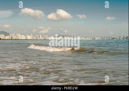 The skyline of Sanya seen from Sanyawan, the beach of Sanya Bay. - Stock Photo