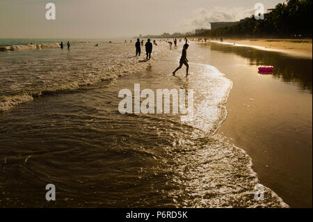 People enjoying the beach of Sanya Bay on a summer afternoon, Sanya, China - Stock Photo