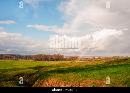 Beautiful flat landscape on a Sunny summer day after a thunderstorm. Rainbow. Copy space. - Stock Photo