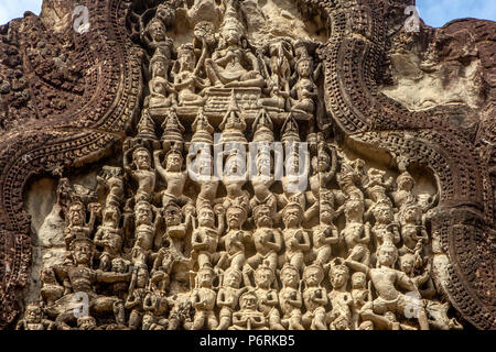 Ornately carved sandstone pediment at Angkor Wat temple at Siem Reap, Cambodia. - Stock Photo