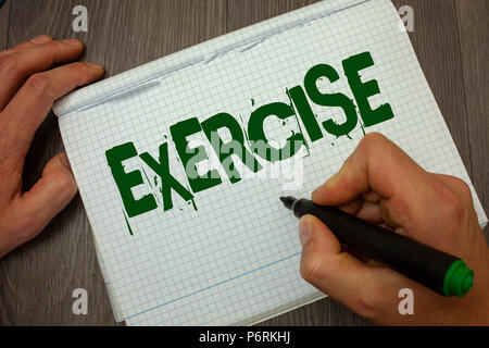 Conceptual hand writing showing Exercise. Business photo text Activity requiring physical effort Bringing into play Training Man hold holding black ma - Stock Photo