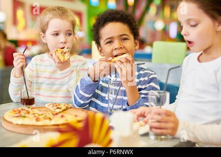 Children in Pizzeria Cafe - Stock Photo