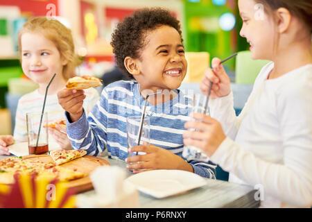 Happy  Children in Pizzeria - Stock Photo