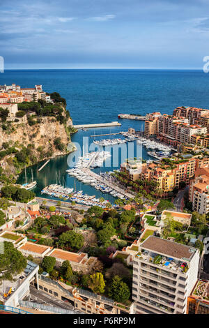 Monaco principality aerial view, apartment buildings at Port de Fontvieille, marina with yachts and sailing boats on Mediterranean Sea - Stock Photo