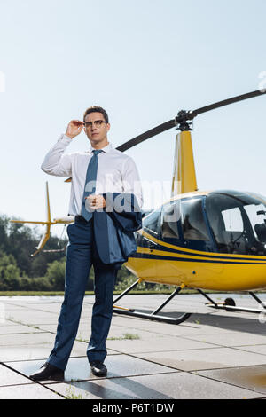 Handsome young businessman checking out heliport condition - Stock Photo