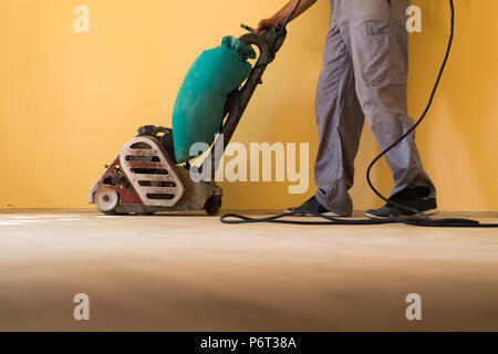 Home renovation and parquet sanding - Stock Photo